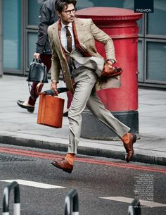 Andres Velencoso Segura is a man on the move in a coat, suit, shirt and tie from Dunhill.