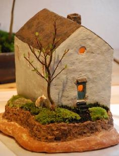 """Masaaki Nakao were implanted mini bonsai to House's pottery was to lighting in the """"House Plants"""" to put the LED light."""
