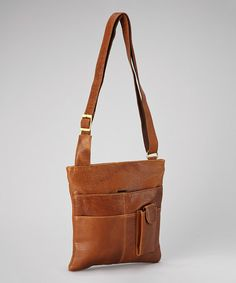 Carry the essentials in understated elegance. Crafted of genuine leather and boasting a plethora of pockets, this modern crossbody makes for a luxurious and durable accessory that can tote an iPad and other daily necessitiesin style.10.5'' W x 11'' H x 0.5'' DMaximum strap length: 26''LeatherImported