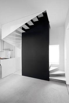 white stair + black wall
