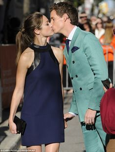 Loved-up: Eddie Redmayne shared a smooch with fiancé Hannah Bagshawe as they arrived at The Theory of Everything premiere on Sunday