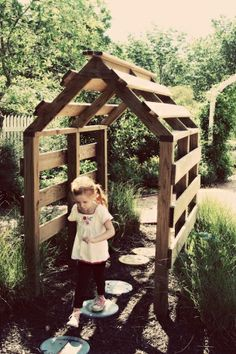 This would be cute to build in front of the girls playhouse. Then plan a vine on both sides. Or even grapes.