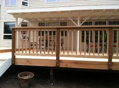 Attach railing posts to outside - less trimming of composite deck boards around the posts