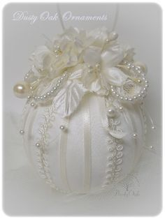 I made this wedding ornament with satin and lace from the brides gown.