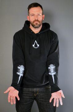 Assassin's Creed hidden blade sweatshirt. $40! Having the hidden blades as a tattoo on the arm? Priceless.