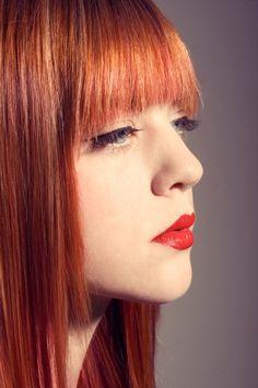 Stunning redhead w/ bangs