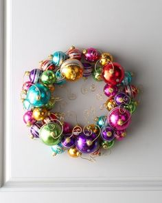 Holiday Ball Wreath, $135.00: Im thinking I could recreate this with a Dollar Tree wreath ring covered in bright ribbon, cheap ornaments, hot glued on and a little glitter... Christmas craft for under 10$??