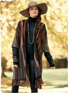 Ikat striping from a Middle Eastern shawl patterns this striking alpaca knit jacket. In earthy shades of taupe, russet, black and rose.
