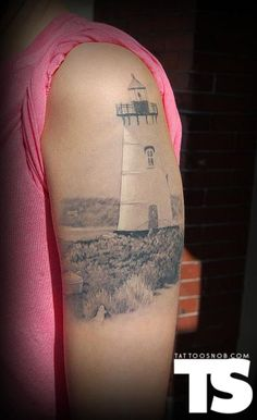Lighthouse tattoo by Carlos Lopez, holy shit it looks like the real thing.