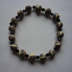 Bracelet élastique / perles style léopard et noires