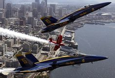 Great shot of Blue Angels 5 and 6 and Sean Tucker in the Oracle biplane.