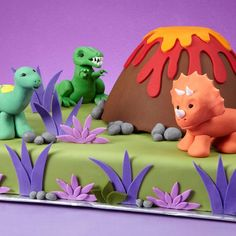 Dino-mite Cake - Bring a prehistoric page of history to life, complete with dinosaurs and a volcano. Use our 11 in. x 15 in. Sheet Pan and Classic Wonder Mold to set the scene.