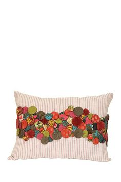 I love this pillow with felt-covered circles on it. Might try to make it myself!
