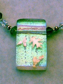 Silver leaves as an inclusion between Dichroic and clear glass.  Nice info on various inclusions used in fused glass.