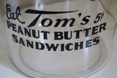 """Very """"RARE"""" 1930'3   """"Eat Tom's  Peanut Butter Sandwiches 5 cents""""  Glass Country Store Jar. $99.00, via Etsy."""