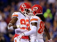 INDIANAPOLIS, IN - JANUARY 04: Wide receiver Dwayne Bowe #82 celebrates with wide receiver Junior Hemingway #88 of the Kansas City Chiefs against the Indianapolis Colts during a Wild Card Playoff game at Lucas Oil Stadium on January 4, 2014 in Indianapolis, Indiana. (Photo by ...
