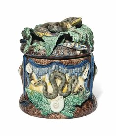 A CONTINENTAL MAJOLICA PALISSY-STYLE JAR AND COVER LATE 19TH CENTURY.