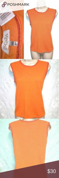 "Vintage Escada Cashmere Beaded Shell/Tank - Orange From Margaretha & Wolfgang Ley's Escada, it's a 100% cashmere, beaded top in navel-orange. The iridescent beads are more grapefruit-flesh toned. Tagged 40, but measurements are: top-shoulder breadth: 15.25-16.25""; bust: 35-38""; waist: 35-38""; high-hips/hem: 35-38""; length, from mid-top shoulder to hem: 23"". Excellent condition, with one almost imperceptible flaw (shown, heightened). There's a tiny, neat mend of a few loops at back, left…"