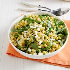 Combine the sweetness of green beans with the creamy saltiness of feta and balance it with hearty pasta and peppery arugula. #food #salad