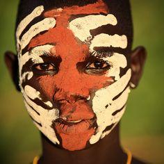 Ethiopia, tribes, Surma, Suri people  Young Suri boy with beautiful face painting in Kibish