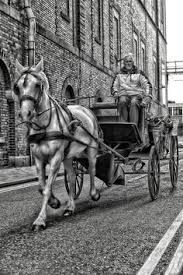 A black and white view of a horse and carriage going by the Guinness Brewery in Dublin Ireland. Image Photography, Travel Photography, Guinness Brewery, Guinness Storehouse, Horse Carriage, Republic Of Ireland, Emerald Isle, 12th Century, Dublin Ireland