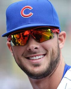 Before first major league game 4-17-2015 in Wrigley. Chicago Cubs' Kris Bryant smiles as he signs autographs before a baseball game against the San Diego Padres.