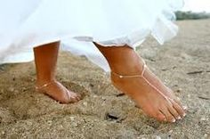 This one isn't that cute but little foot things like this instead of sandals kicking up sand walking down the isle:)