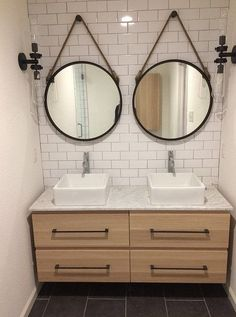 """After"" photos of 10th flip - It's Great to Be Home. Master bathroom with floating Ikea Godmorgon vanity in white oak finish, gray porcelain tile floor, black hardware, round captain mirrors, vessel sinks, modern rustic, subway tile with gray grout"