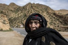 Mazouza Bouglada, 86, a berber woman from the Chaouia region, who has facial tattoos, poses for a photograph in Taghit in the Aures Mountain, Algeria October 8, 2015. Bouglada was tattooed aged 7 by a nomadic man from the Sahara region. She was advised by her mother to get tattooed. The more she got tattooed the more she showed off. Even if she still remembers the pain, she felt beautiful once it was done, Bouglada said. (Photo by Zohra Bensemra/Reuters)