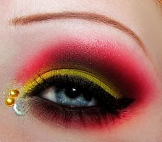 Yellow and red eyeshadow look with rhinestones