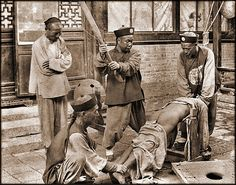 Vintage Photographs of Pre-Revolution China, 1870-1946 - Chinese Punishment, Whipping A Lawbreaker [c1900] Attribution Unk