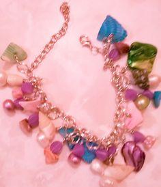 Sea Shell Charm Bracelet. Available at shanonsbeadcreations.etsythemeshop.com.