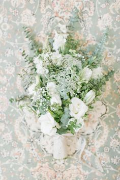 Greenery & white flower bouquet | SouthBound Bride | http://www.southboundbride.com/contemporary-rustic-wedding-at-zakopane-country-lodge-by-louise-vorster-nadea-riaan | Credit: Louise Vorster