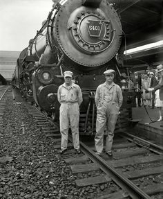 """The engine crew of Pennsylvania Class K-4s 4-6-2 #5401 take a moment for a photo in front of their locomotive which will lead the newly christened """"Senator"""" (Washington - Boston) from Washington Union Station on July 14, 1929. Glass-plate negative by Harris & Ewing."""