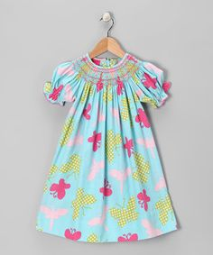 With a playful print and smocked neckline, this bishop dress puts a whimsical spin on a childhood classic. Back button closures and cuddly corduroy make it easy for every prim princess to wear with flair.