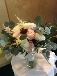 Garden roses, ranunculus,astilbe and lots of silver dollar eucalyptus in this lush bridal bouquet