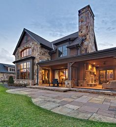 Fantastic stone covered porch | stone fireplace | disappearing screen