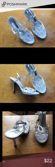 Silver dress women shoe These are the perfect dress shoe for a special occasion. It is silver size 9.5  and have a heal. These shoes were hardly worn and kept in a smoke free environment. the touch of Mima Shoes Heels
