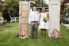 Bride and Groom showing off their outside wedding vintage decor   #vintagewedding #vintagedecor #blossomblueweddings