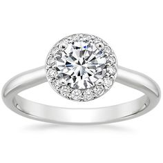 Love this website! Allows you to customize ring setting and choose a diamond based on size/price/color/etc. Love, love, love the halo setting! White gold or platinum.