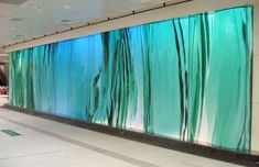 Emerald Laminata: Infinity, view of three-dimensional glass wall, companion to the glass wall Tree of Life
