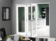 Finesse White 3 door internal bi-fold doors and room divider consists of a single glass pane of toughened safety glass with no bottom track for seamless flooring. Decorative Room Dividers, Sliding Room Dividers, Room Divider Doors, Room Doors, Sliding Doors, Bifold Glass Doors, Bi Fold Doors Internal, Internal Door Handles, Interior Barn Doors