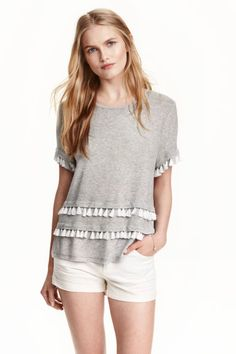 Jersey top: Short-sleeved top in soft jersey with decorations on the front.