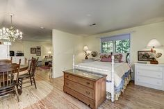 Mountain cottage with floral chintz, rooster lamps, and matelasse duvet