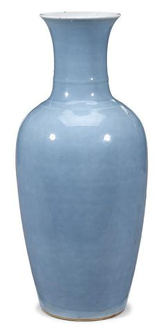Large Chinese clair-de-lune glazed three-string vase    qing dynasty    The high shouldered slender vase covered in a pale sky blue glaze with three string bands adorning the trumpet neck, the glaze trimmed neatly around white concave base with six character Kangxi mark to base.    H: 18 inches