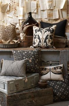 This could easily be a craft fair booth selling pillows. Book pages and the background and other home decor items communicate the vibe of the collection.