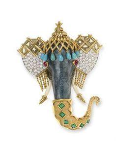 Jean Schlumberger, années 1980. Broche Eléphant avec turquoise, brillant, rubis, émeraudes et or.
