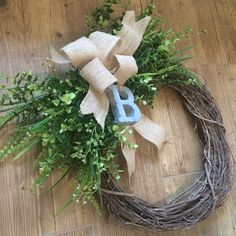 A personal favorite from my Etsy shop https://www.etsy.com/listing/466847601/momogrammed-greenery-grapevine-wreath