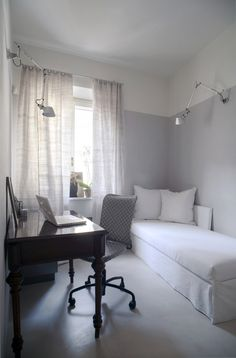 Grey & white + linen curtains - Apartment in Prato Italy, with gray walls painted to datum line, Artemide Tolomeo desk lamp, Remodelista
