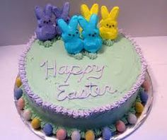 """Another easy and cute Peep Easter cake! Bake your favorite cake mix in two 9"""" round pans. After icing the middle, top and sides with buttercream icing, pipe the two borders at the base and top edges of the cake. Then, place jelly beans around the bottom border- that border of frosting keeps the jelly beans in place. Place your Peeps bunnies on top, and pipe your wording on top! Voila."""